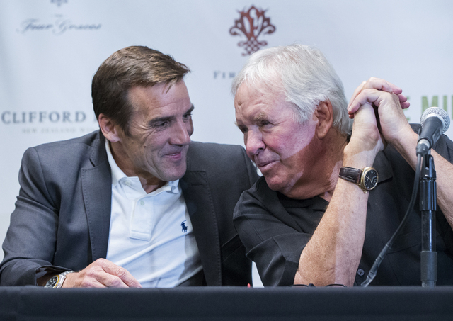 New general manager George McPhee, left, and Bill Foley, owner of Las Vegas' NHL expansion team, talk on stage during a press conference at T-Mobile Arena on Wednesday, July 13, 2016, in Las Veg ...