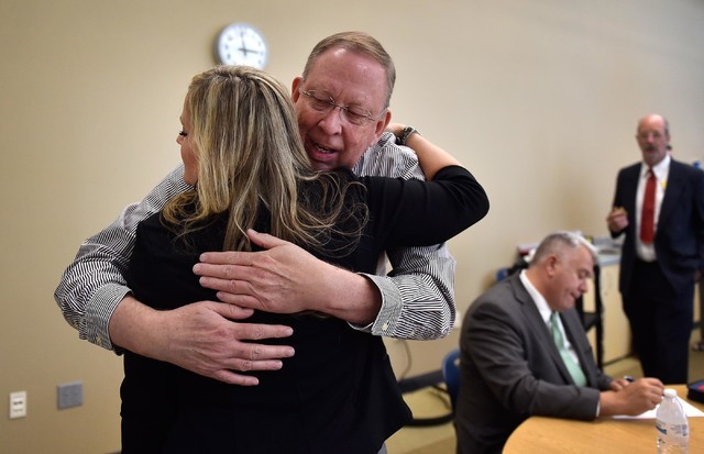 Sally Calloway, left, trainer with the Platform to Employment program receives a hug from Robert Barclay after his graduation from the five-week program designed to help veterans return to work du ...