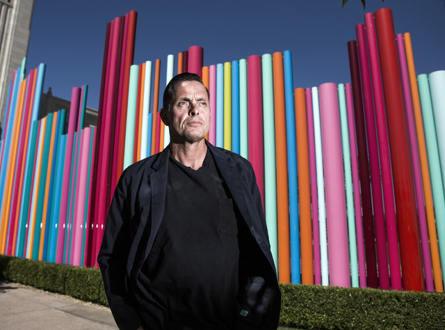 Artist Tim Bavington stands in front of the Pipe Dream art piece he created in Symphony Park at The Smith Center for the Performing Arts on Tuesday, July 12, 2016. Jeff Scheid/Las Vegas Review-Jou ...