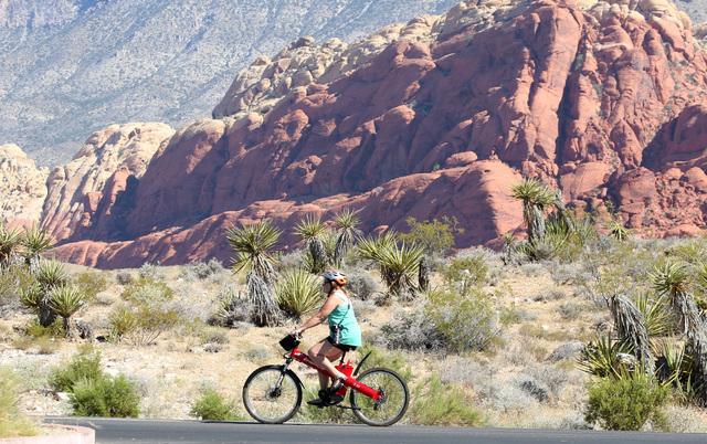 A woman rides her bike during a hot day at Red Rock Canyon on Wednesday, July 13, 2016. (Bizuayehu Tesfaye/Las Vegas Review-Journal Follow @bizutesfaye)