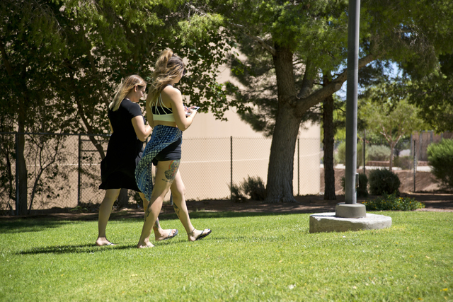 Castin Iglinski, right, and Shannon Iglinski use the Pokemon Go app at O'Callahan Park in Henderson on Saturday, July 16, 2016. Daniel Clark/Las Vegas Review-Journal Follow @DanJClarkPhoto