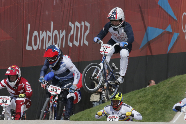 The United States' Connor Fields (11) leads the competition in a BMX cycling men's quarterfinal run during the 2012 Summer Olympics in London, Aug. 9, 2012. (Christophe Ena, File/AP)