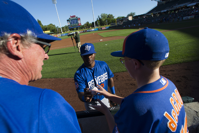 Las Vegas 51s player Dilson Herrera signs a ball for a fan before playing against the Salt Lake Bees at Smith's Ballpark in Salt Lake City on Sunday, June 19, 2016. Chase Stevens/Las Vegas Review- ...