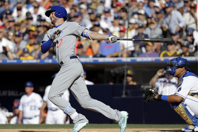 National League's Kris Bryant of the Chicago Cubs follows through on a solo home run during the first inning of the MLB baseball All-Star Game against the American League, Tuesday, July 12, 2016,  ...
