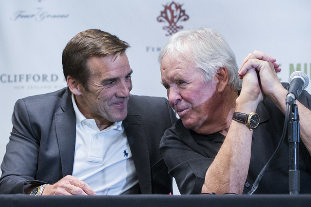 New general manager George McPhee, left,  and Bill Foley, owner of Las Vegas' NHL expansion team, talk on stage during a press conference at T-Mobile Arena on Wednesday, July 13, 2016, in Las Ve ...