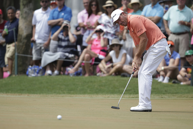 Alex Cejka of Germany, putts on the fifth green during the final round of The Players Championship golf tournament Sunday, May 15, 2016, in Ponte Vedra Beach, Fla. (Lynne Sladky/AP)