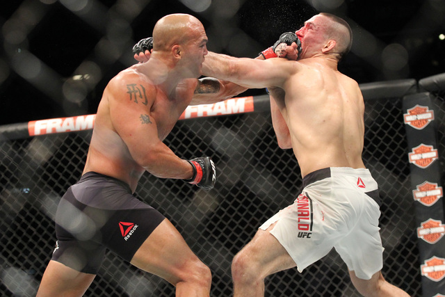 Robbie Lawler, left, trades jabs with Rory MacDonald during their welterweight title bout at UFC 189 at the MGM Grand Garden Arena Saturday, July 11, 2015, in Las Vegas. Lawler won by technical kn ...
