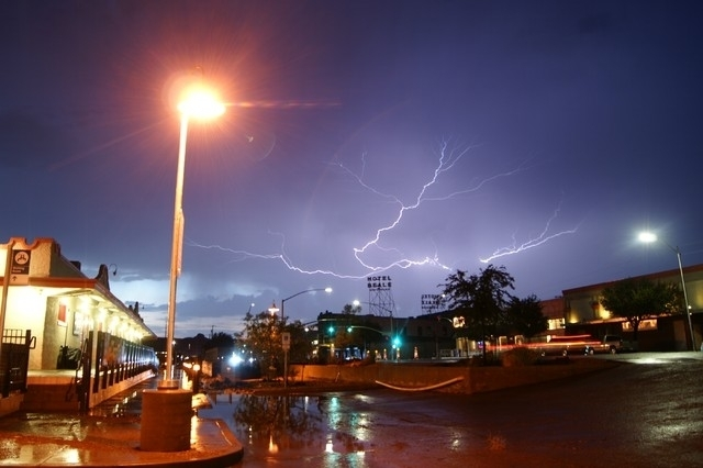 Lightning rakes the sky over the corner of Third and Beale Streets in Kingman, Ariz. on Monday, July 14, 2014 during a fierce monsoon season thunderstorm. . (Herberta Schroeder/Special to the Las  ...