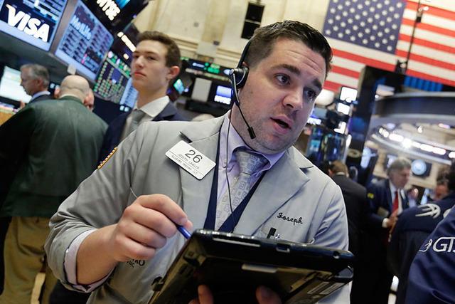 Trader Joseph Lawler works on the floor of the New York Stock Exchange.  (Richard Drew/AP)