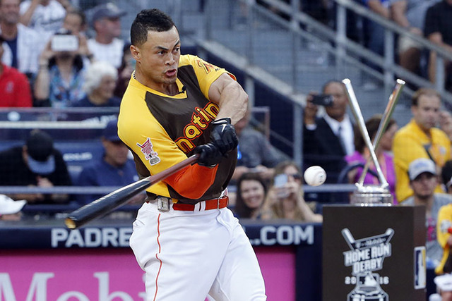 National Leagues Giancarlo Stanton, of the Miami Marlins, hits during the MLB baseball All-Star Home Run Derby, Monday, July 11, 2016, in San Diego. (AP Photo/Lenny Ignelzi)