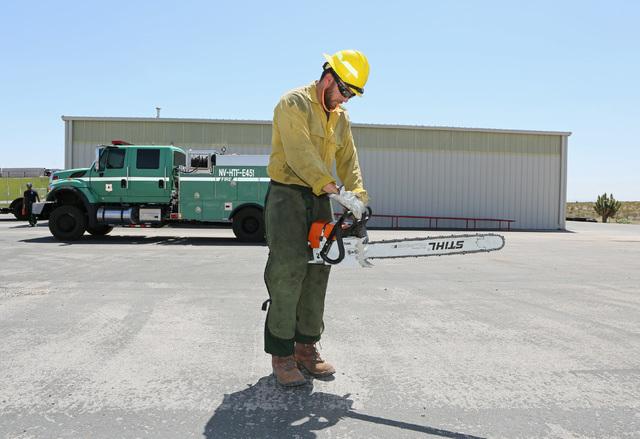 Bureau of Land Management firefighter Kenneth Fruend performs an equipment check in  June. (Ronda Churchill/Las Vegas Review-Journal)