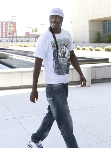 Robbery defendant Brian Wright arrives at the Lloyd George U.S. Courthouse for his sentencing on Thursday, July 21, 2016. Wright previously won his temporary freedom because of procedural errors b ...
