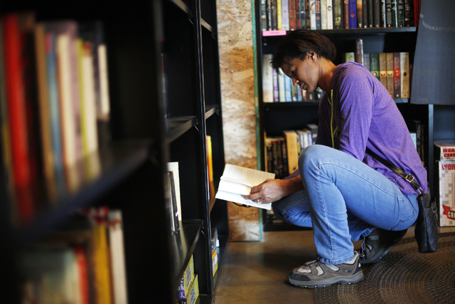 Verna Neal looks at a book at the Writer's Block in downtown Las Vegas June 7. The bookshop is slated to host a local author spotlight event on July 30. View file photo