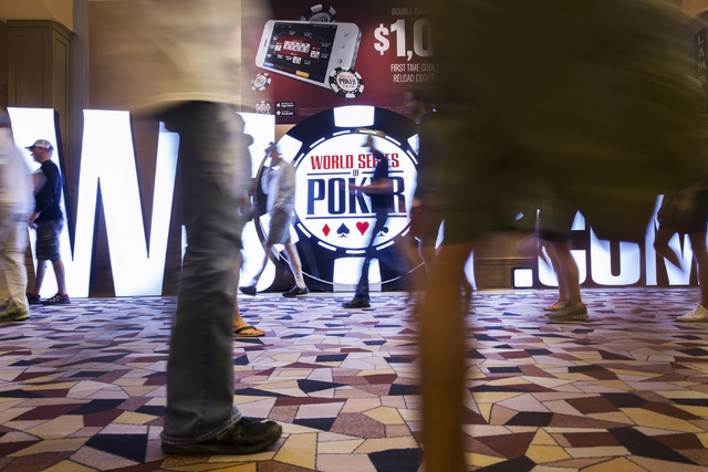 Attendees walk the hallways at the World Series of Poker at the Rio Convention Center on Tuesday, July 12, 2016, in Las Vegas. (Benjamin Hager/Las Vegas Review-Journal)