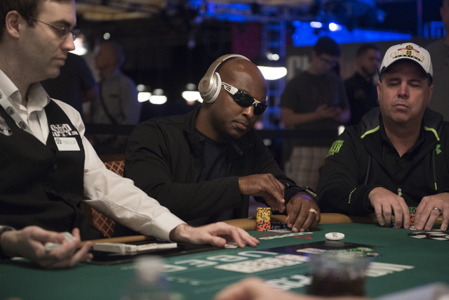 Former NFL player, Antoine Winfield, center, plays in Flight A during Day 1A of the Main Event of the World Series of Poker at the Rio Convention Center in Las Vegas Saturday, July 9, 2016. Jason  ...