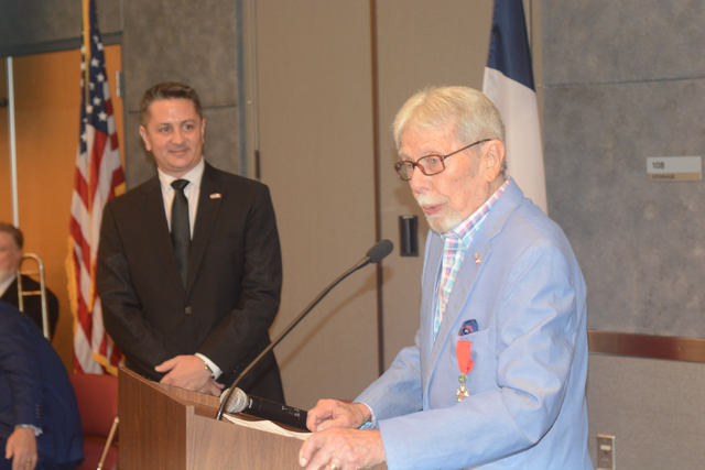 U.S. Army Pfc. and Las Vegas resident Robert Stava, right, speaks after receiving the Legion d'Honneur ѠFrance's highest decoration Ѡon Saturday, July 16, 2016, at the Atomic Testing M ...