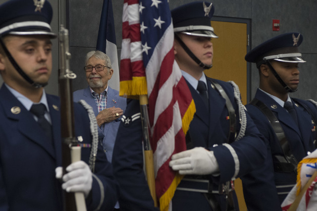 Pfc. and Las Vegas resident Robert Stava places his hand over his heart during the national anthem, prior to receiving his honors on Saturday, July 16, 2016, at the Atomic Testing Museum in Las Ve ...