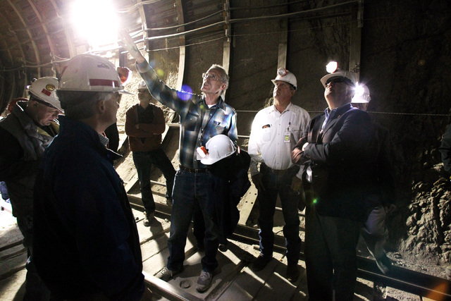 Department of Energy geologist William Boyle points out tunnel features to U.S. Rep. Jerry McNearny, D-Calif., left, Rep. Cresent Hardy, R-Nev. and Rep John Shimkus, R-Ill. during a congressional  ...