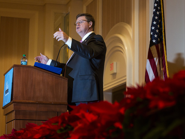 "U.S. Rep. Mark Amodei, R-Nev., addresses the Las Vegas Chamber of Commerce's ""Eggs & Issues"" breakfast on Dec. 16, 2013. A Nevada Republican Party committee has endorsed Amodei for re-election ..."