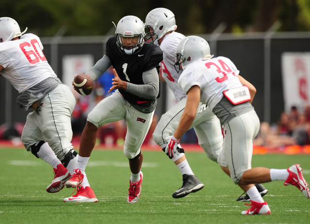 UNLV quarterback Armani Rogers rolls out of the pocket during a scrimmage at UNLV in Las Vegas, Friday August 19, 2016.  (Josh Holmberg/Las Vegas Review-Journal)