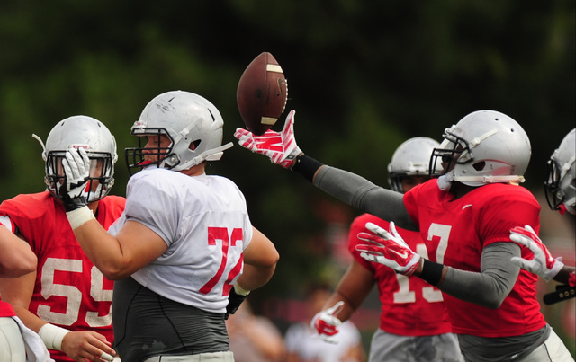 UNLV defensive lineman Jamal Halloway intercepts a tipped pass during a scrimmage at UNLV in Las Vegas, Friday August 19, 2016.  (Josh Holmberg/Las Vegas Review-Journal)
