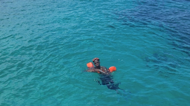UNLV forward Dwayne Morgan swimming in the Atlantic Ocean. (Mark Anderson/Las Vegas Review-Journal)