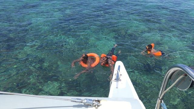 UNLV players swimming in the Atlantic Ocean. (Mark Anderson/Las Vegas Review-Journal)