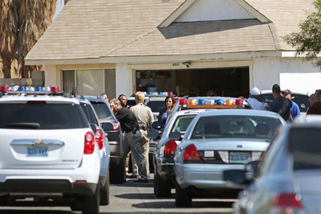 Police respond to an officer-involved shooting in the 6900 block of Berkshire Place on Friday, Aug. 7, 2015, in Las Vegas. Police checking reports of a broken window shot and killed a man who lung ...