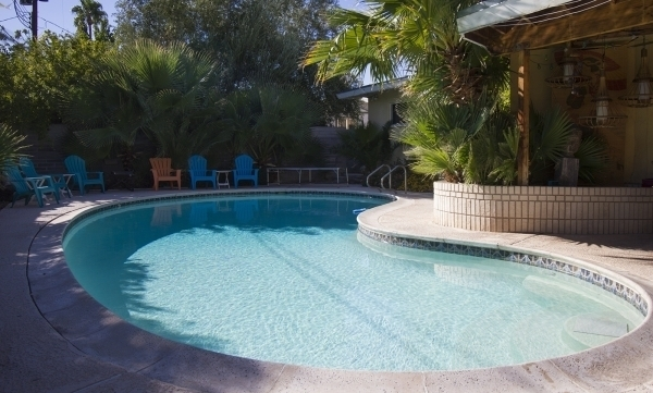 Lanterns lend a tiki vibe beside the kidney-shaped pool at Michelle Larime's 1952 ranch home in Beverly Green. The architectural designer, 34, supports creating a city of Las Vegas historic dist ...