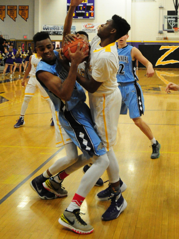 Centennial guard Troy Brown, left, fights for a rebound with Durango forward Zyare Ruffin in the first quarter of their prep basketball game at Durango High School in Las Vegas Friday, Jan. 8, 201 ...