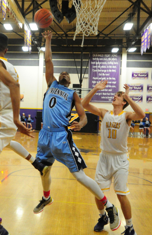 Centennial guard Troy Brown (0) goes up for a shot in front of Durango forward Jason Landman (10) in the first quarter of their prep basketball game at Durango High School in Las Vegas Friday, Jan ...