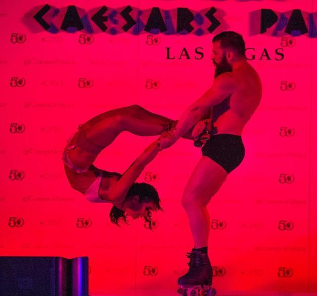 """Brother-and-sister Billy and Emily England of """"Absinthe"""" perform during Caesars Palace's 50th anniversary celebration Friday, Aug. 5, 2016, at Garden of the Gods Pool Oasis. (Tom Donoghue)"""