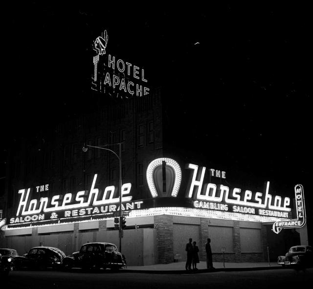 In this Las Vegas News Bureau file photo the Hotel Apache marquee is seen above the Horseshoe hotel-casino in downtown Las Vegas on Jan. 1, 1951. Photo/Las Vegas News Bureau