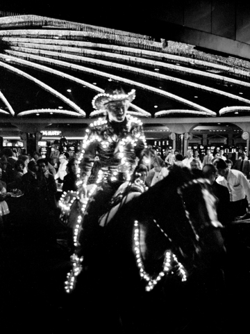 """Rodeo champ Sonny Steele (Robert Redford) and thoroughbred champ Rising Star escape the confines of the Caesars Palace casino during the 1978 shoot for """"The Electric Horseman."""" Gary Angel/Las Vega ..."""