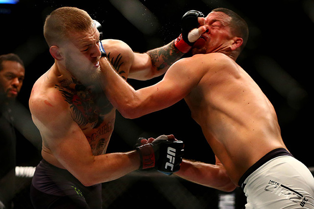 March 5, 2016; Las Vegas, NV, USA; Conor McGregor moves in for a punch against Nate Diaz during UFC 196 at MGM Grand Garden Arena. (Mark J. Rebilas/USA Today Sports)