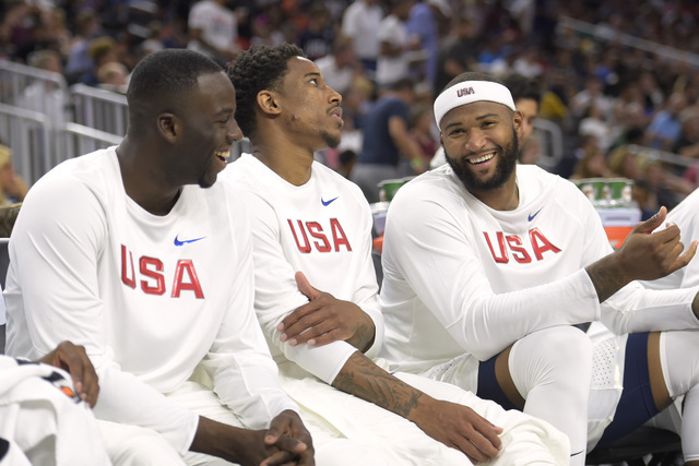 From left, Draymond Green, DeMar DeRozan and DeMarcus Cousins of the United States share a laugh on the bench during a USA Basketball showcase exhibition game against Argentina at T-Mobile Arena i ...