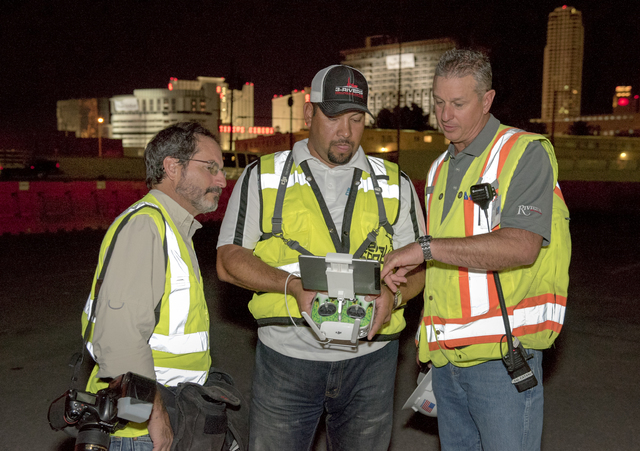 Northstar Contracting Group employees check the video from a drone flight as they prepare to implode the remaining tower of the Riviera early Tuesday, Aug. 16, 2016, in Las Vegas. (Mark Damon/Las  ...