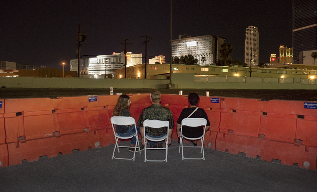 Guests at a Northstar Contracting Group employee viewing event have front-row seats at the implosion of the remaining tower of the Riviera early Tuesday, Aug. 16, 2016, in Las Vegas. (Mark Damon/L ...