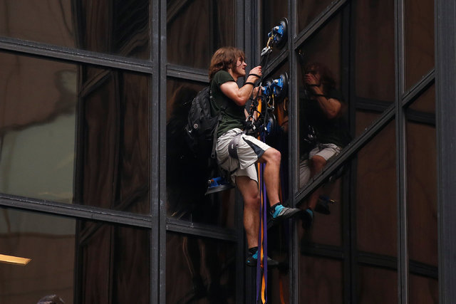 A man using suction cups climbs the outside of Trump Tower in New York City, Thursday, Aug. 10, 2016. (Lucas Jackson/Reuters)