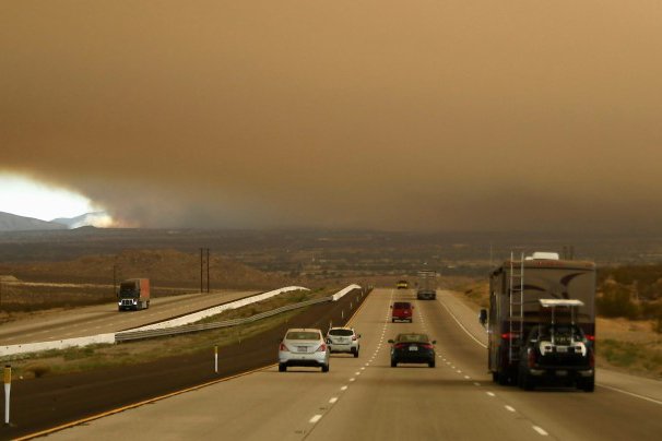 Thick layers of smoke fill the skies along the Interstate 15 freeway from the so-called Bluecut Fire in the San Bernardino National Forest in San Bernardino County, California, U.S. August 16, 201 ...