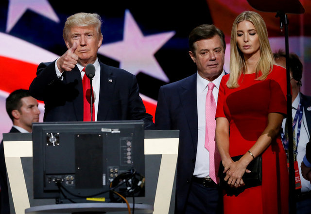 Republican presidential nominee Donald Trump gives a thumbs up as his campaign manager Paul Manafort, center, and daughter Ivanka look on during Trump's walk through at the Republican National Con ...