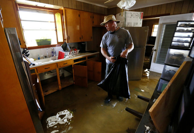 Wallace Floyd stands in his flooded kitchen in Ascension Parish, Louisiana, Aug. 19, 2016.  (Jonathan Bachman/Reuters)