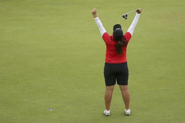 Inbee Park of South Korea reacts on the 18th green as she wins the gold medal in final round women's Olympic golf competition. (Andrew Boyers/Reuters)