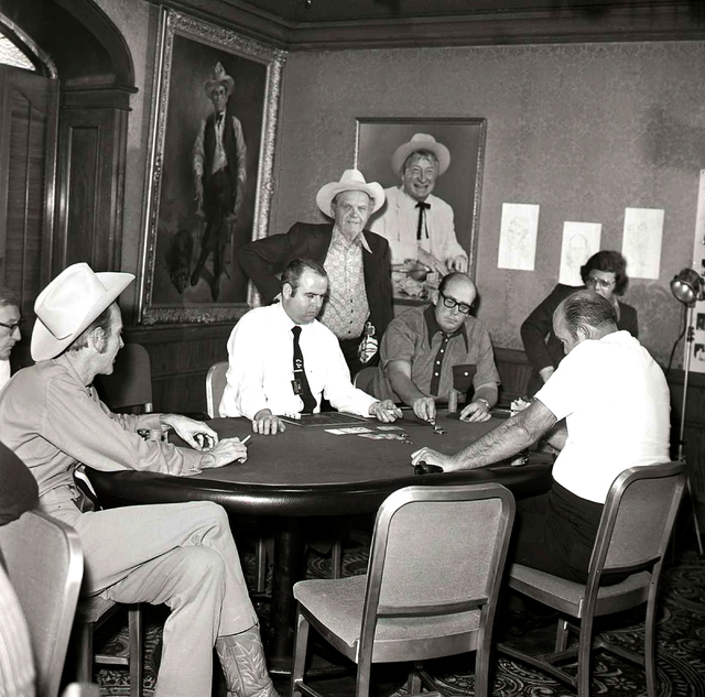 In this Las Vegas News Bureau file photo, Benny Binion, standing, is seen at the World Series of Poker with winner Amarillo Slim Preston, at the end of table, Doyle Brunson, next to dealer and Pug ...