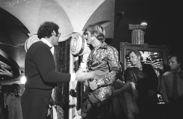 """Director Sydney Pollack, left, and star Robert Redford confer between scenes during production of """"The Electric Horseman"""" at Caesars Palace in December 1978. COURTESY LAS VEGAS NEWS BUREAU"""