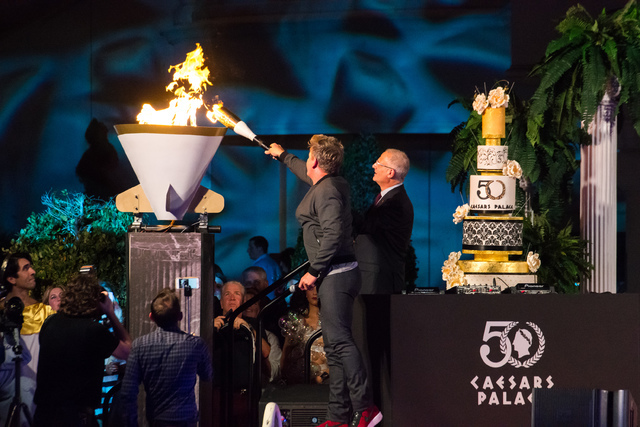 Chef Gordon Ramsay and President Gary Selesner take part in Caesars Palace's 50th anniversary celebration Friday, Aug. 5, 2016, at Garden of the Gods Pool Oasis. (Erik Kabik)