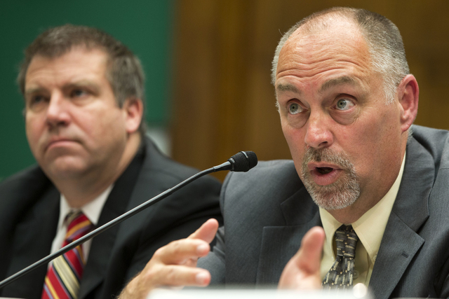 Small Business Fantasy Sports Trade Association Executive Director Steve Brubaker, right, accompanied by MGM Resorts International Executive Vice President John McManus, testifies about daily fant ...