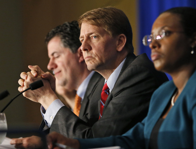 Consumer Financial Protection Bureau Director Richard Cordray, center, listens to comments during a panel discussion in Richmond, Va., March 26, 2015. On June 2, 2016, the bureau announced it is p ...