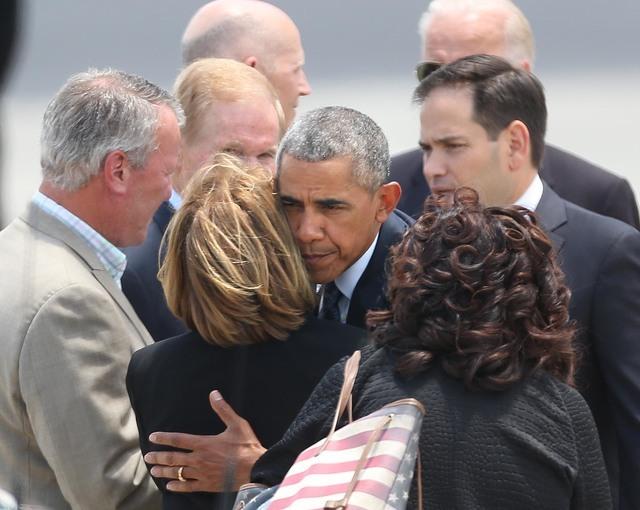 President Barack Obama hugs Orange County Mayor Teresa Jacobs upon the president's arrival at Orlando International Airport, Thursday, June 16, 2016, in Orlando, Fla. Obama is in Orlando today to  ...