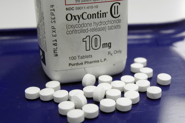 This Feb. 19, 2013, file photo, shows OxyContin pills arranged for a photo at a pharmacy in Montpelier, Vt. With an overdose epidemic worsening, nearly one-third of Medicare beneficiaries received ...